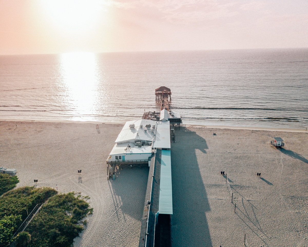 Westgate Cocoa Beach Pier at sunrise from a drone.