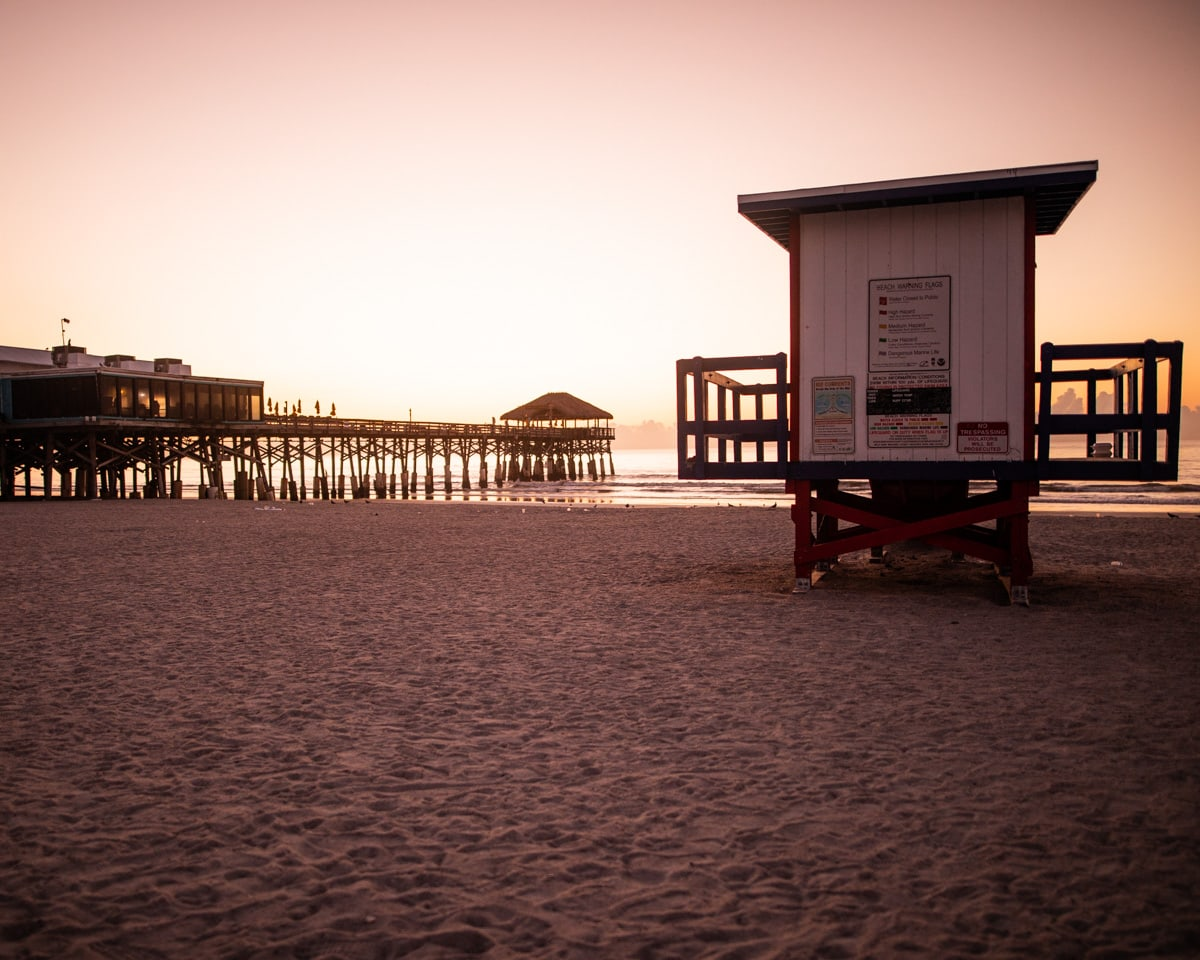 A lifeguard shack next to Westgate Cocoa Beach Pier at sunrise