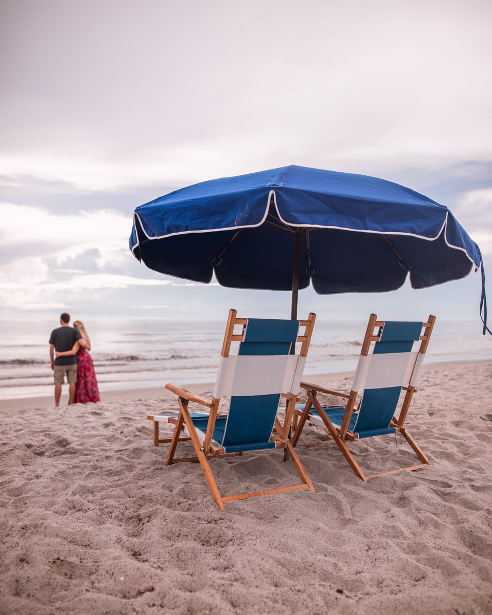 Watching the sunrise by the beach concierge umbrellas and lounge chairs at Cocoa Beach's Westgate Cocoa Beach Resort in Florida.
