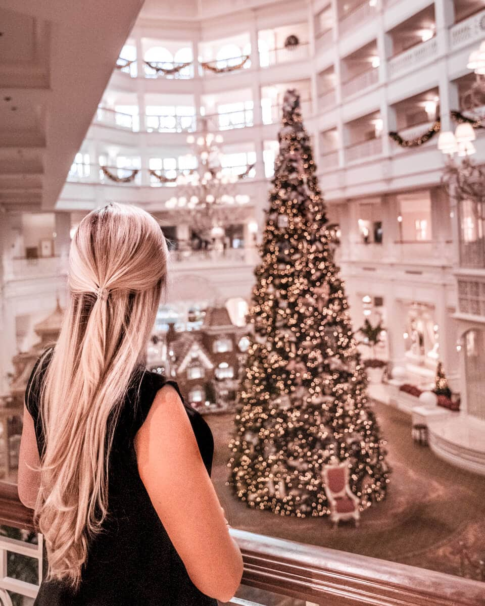 Looking down on the lobby of the Grand Floridian with the Christmas tree from the second level balcony. Get a list of the top things to do in Orlando for Christmas here.