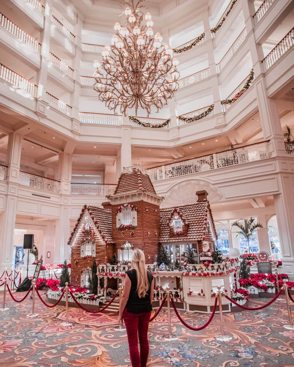 The 14-foot tall gingerbread house in the lobby of the Grand Floridian at Christmas. Get a local's guide to 40+ things to do in Orlando at Christmas here.