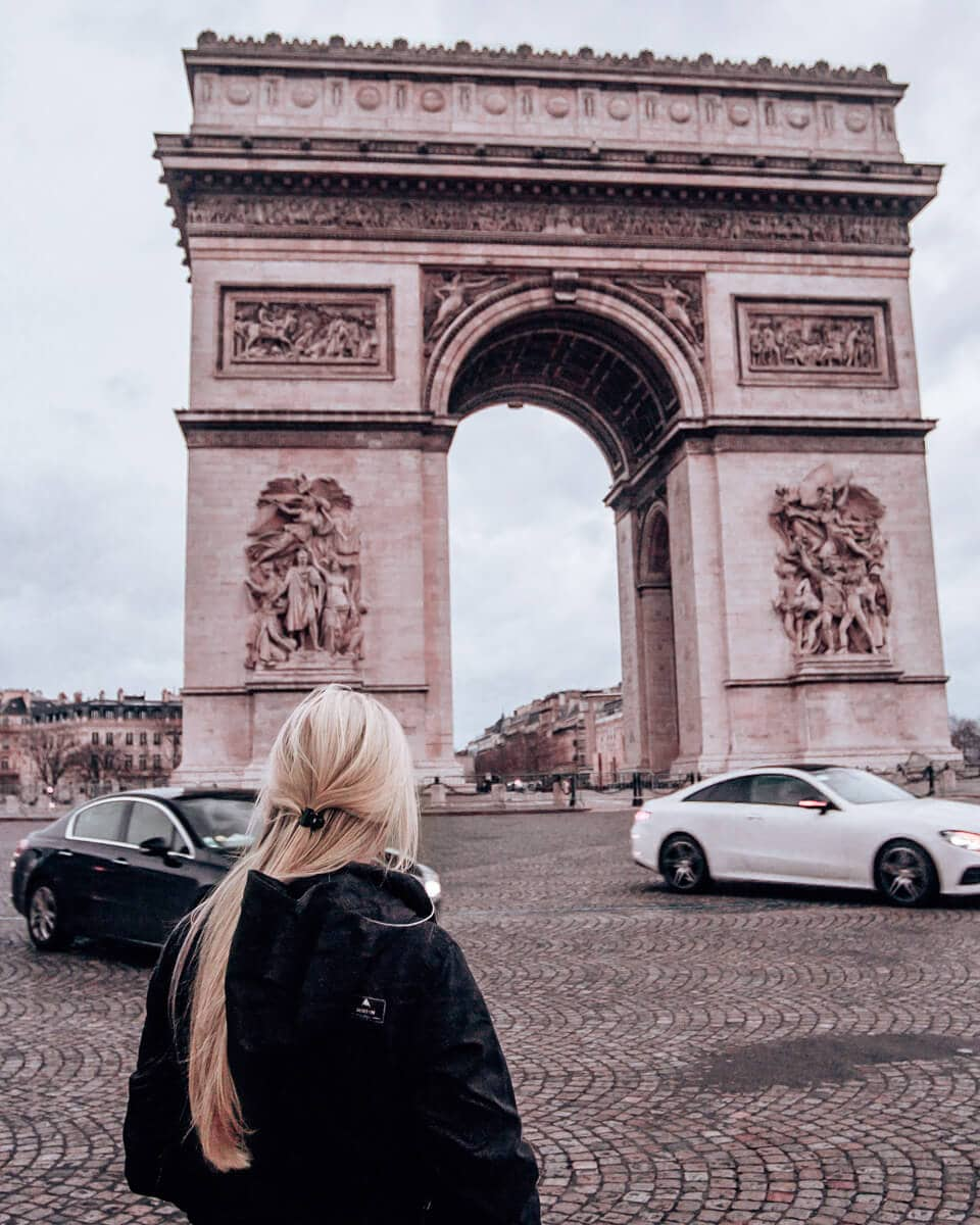 The Arc de Triomphe in Paris from the other side of the roundabout. Find all the best Paris photo spots and a guide to New Year's in Paris here.