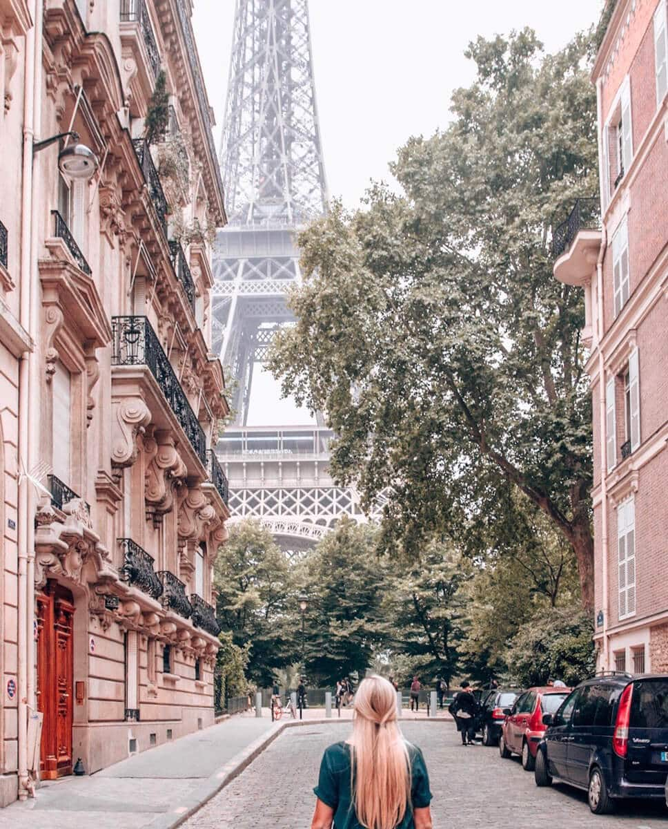 The view of the Eiffel Tower from Rue de l'Universite. Get the best photo spots for the Eiffel Tower and a guide to New Year's in Paris here.