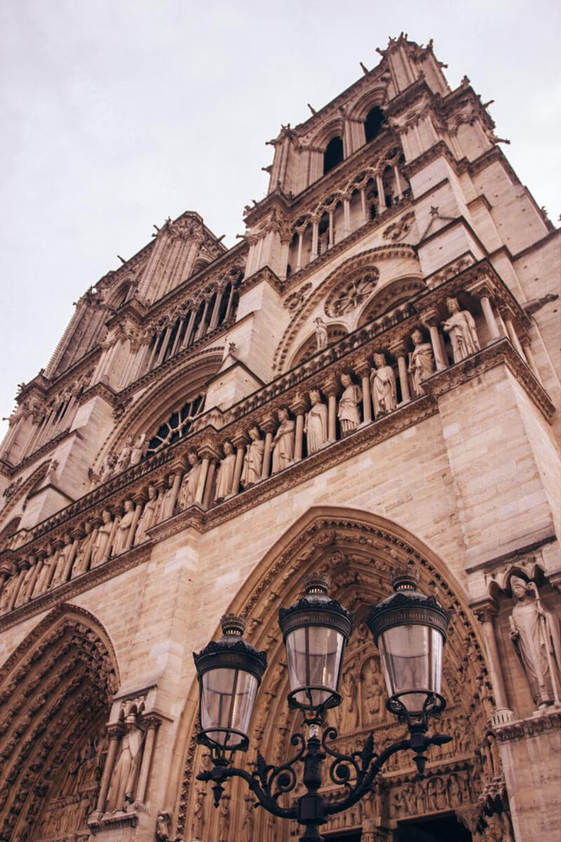 The front of Notre Dame in Paris. Get travel tips for winter in Paris with this guide to New Year's in Paris.