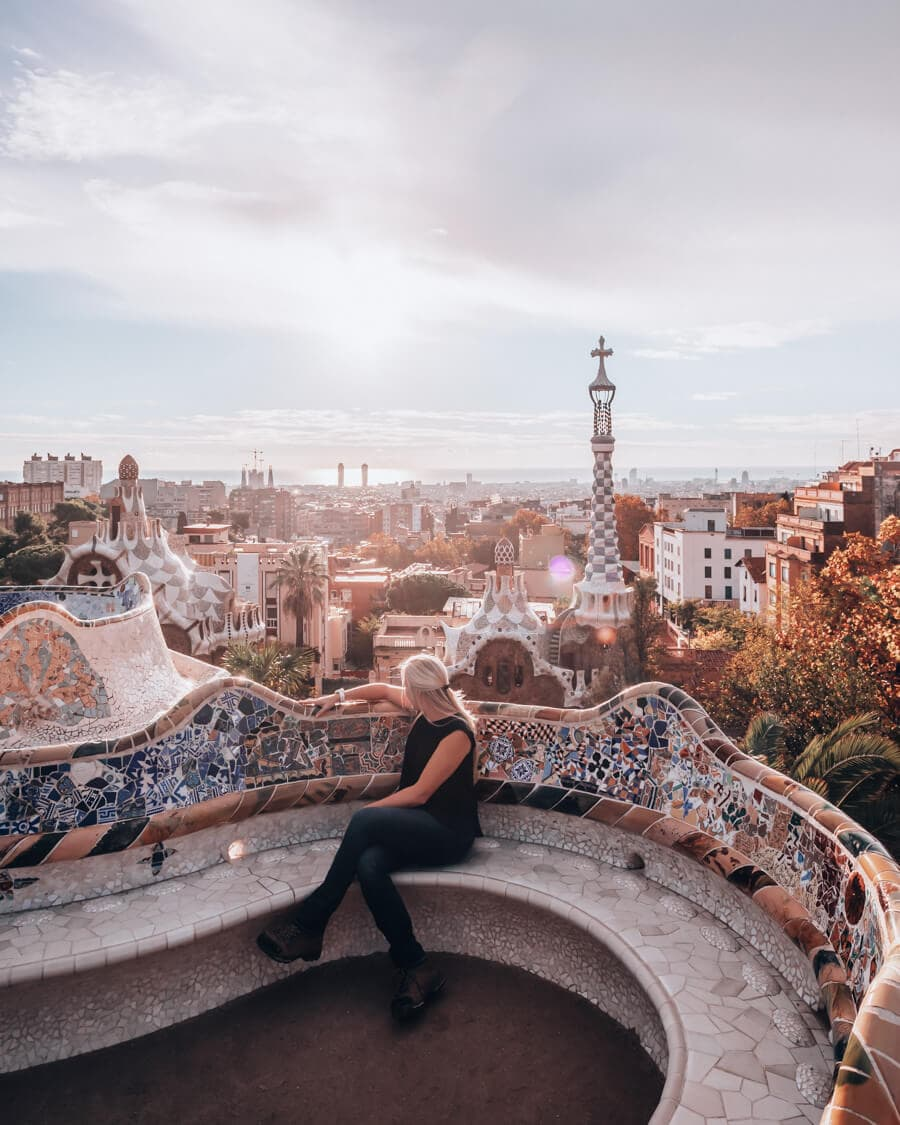 A woman looking out over Barcelona in the Greek Theater in Park Guell