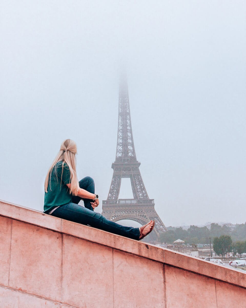 Woman at Trocadero at sunrise with the Eiffel Tower