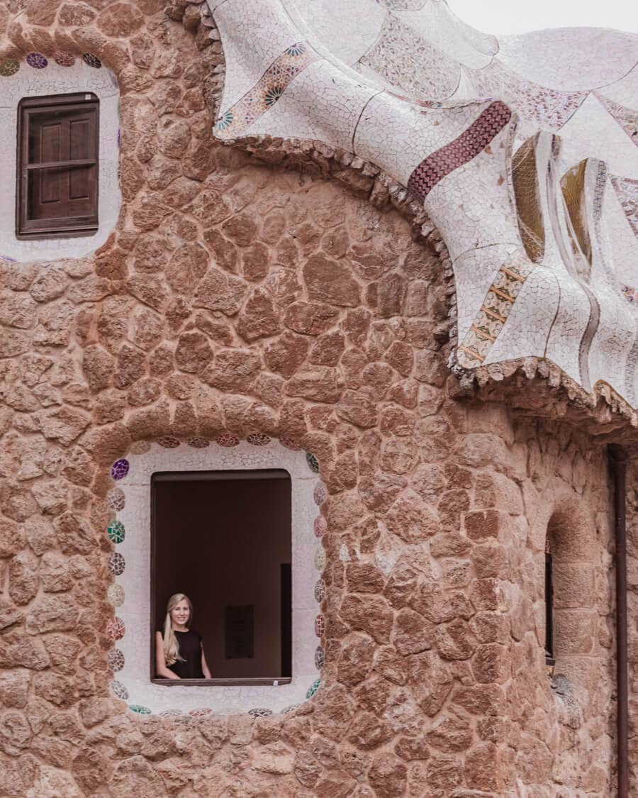 A woman in the window of the Porter's Lodge in Park Guell Barcelona