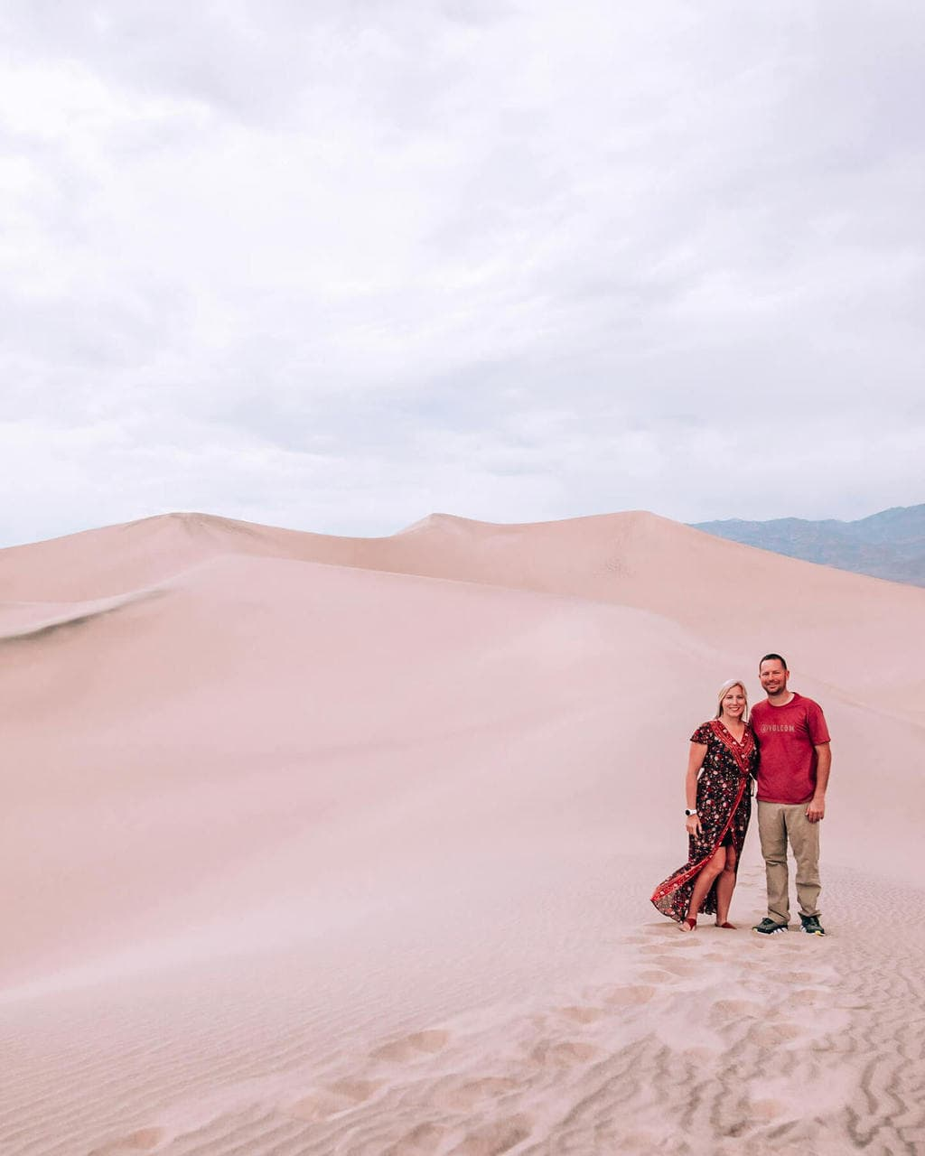A couple on the sand dunes in Death Valley National Park