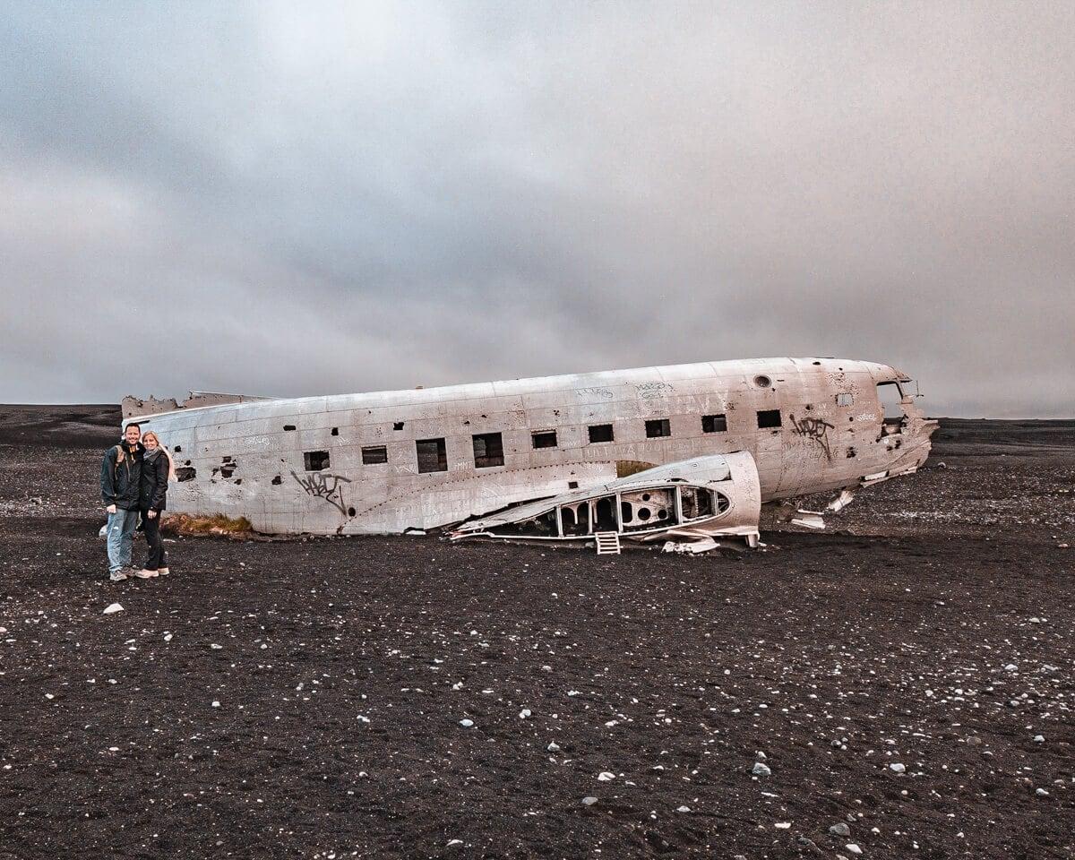 A couple in front of the Sólheimasandur plane crash
