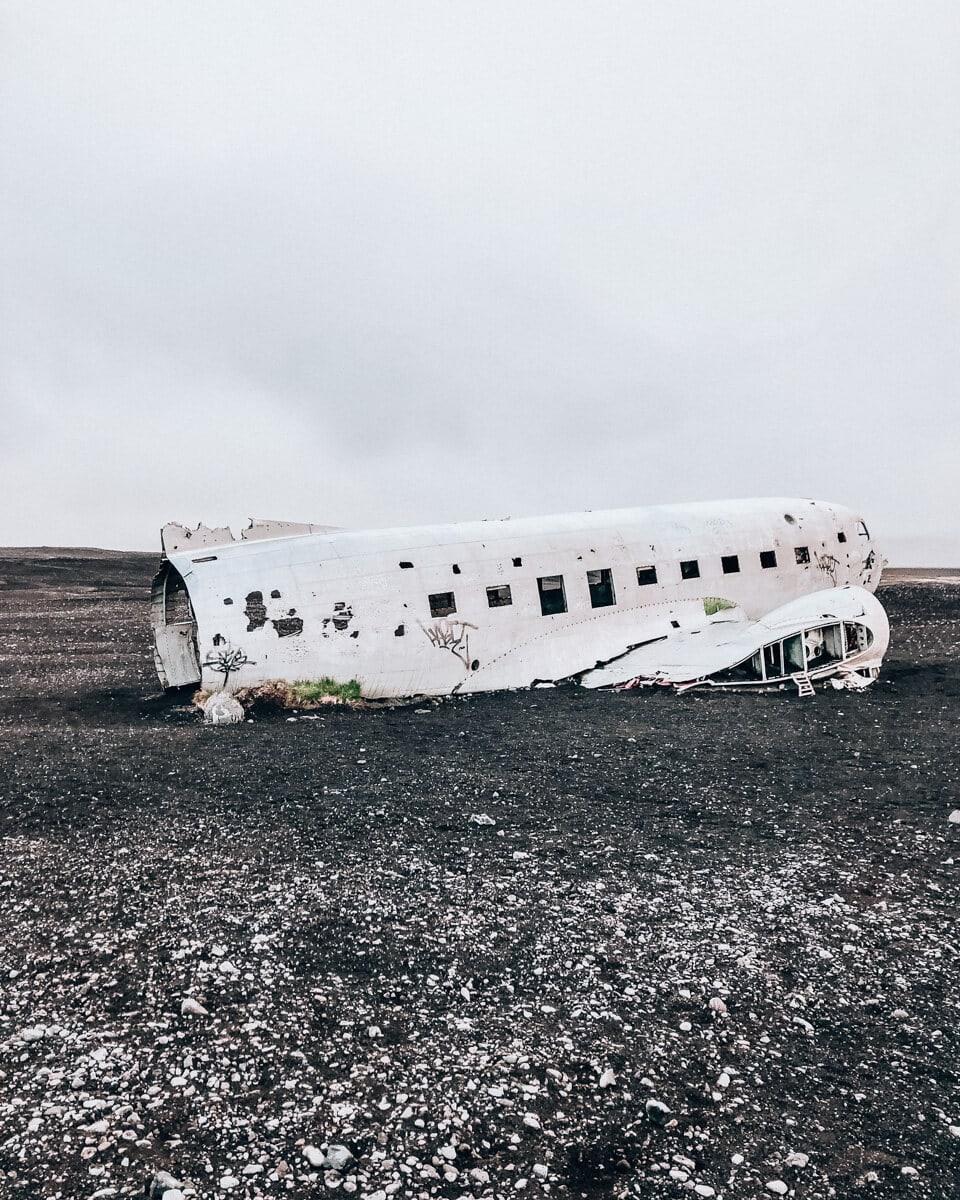 The Sólheimasandur plane wreck on a black sand beach in Iceland