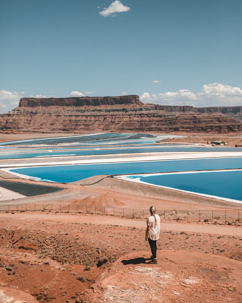 woman looking at potash pond moab utah