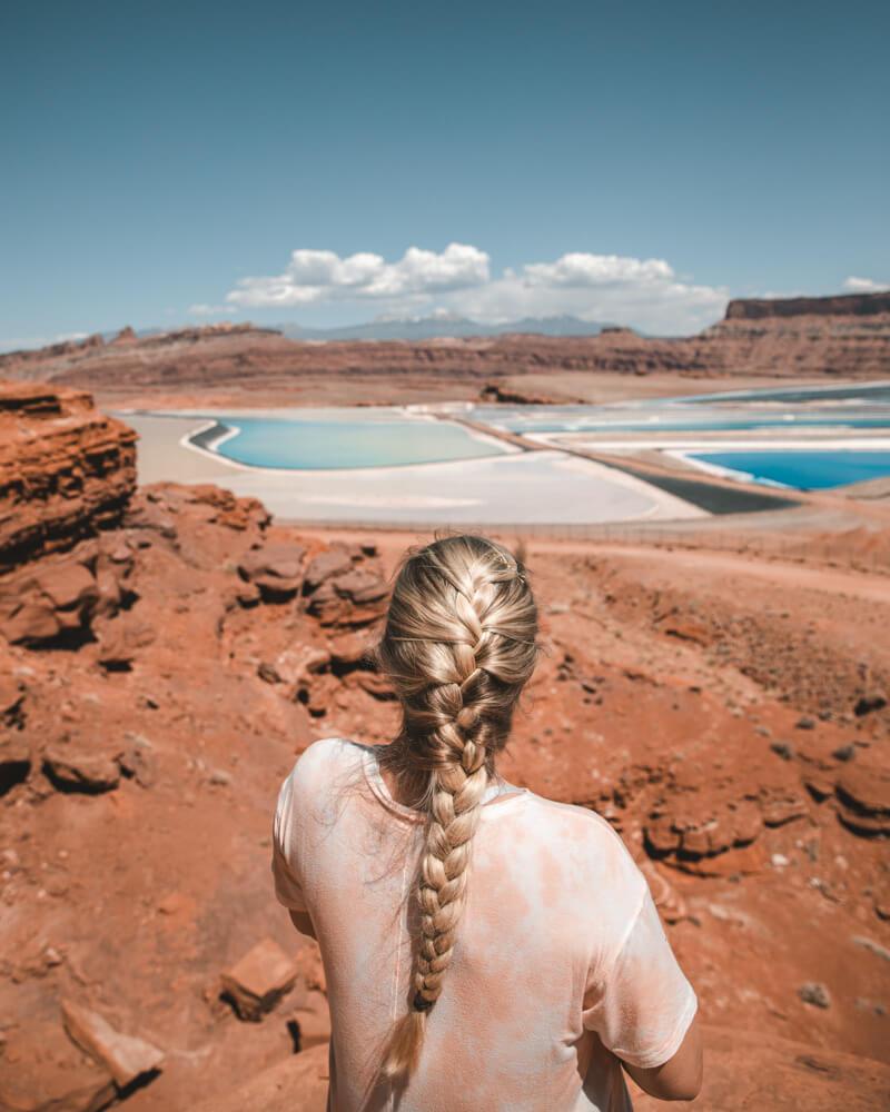 woman looking at the potash evaporation ponds in utah