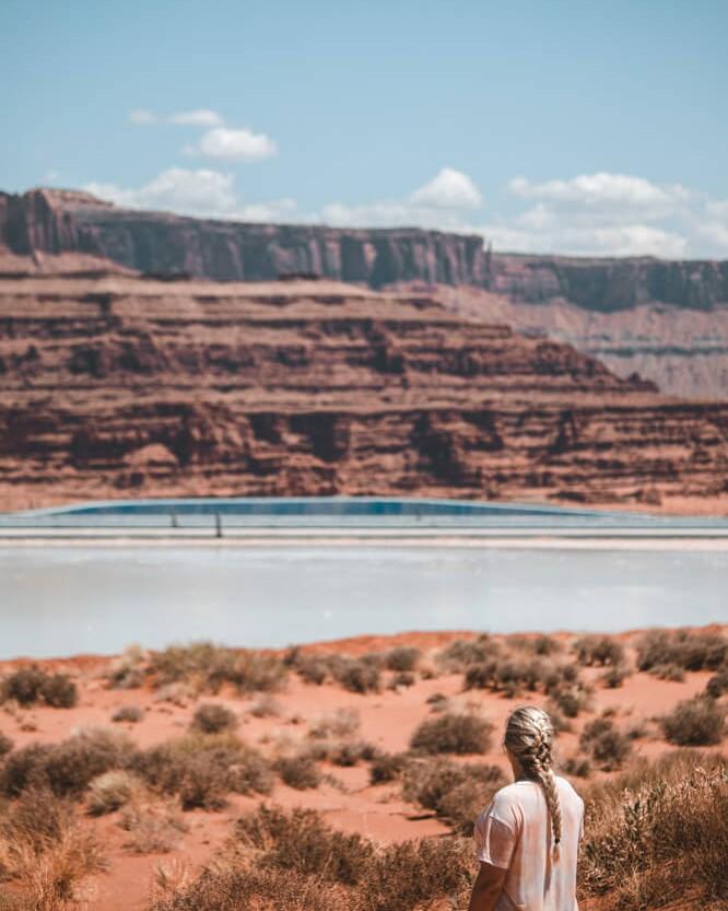 woman looking at texas gulf potash pond