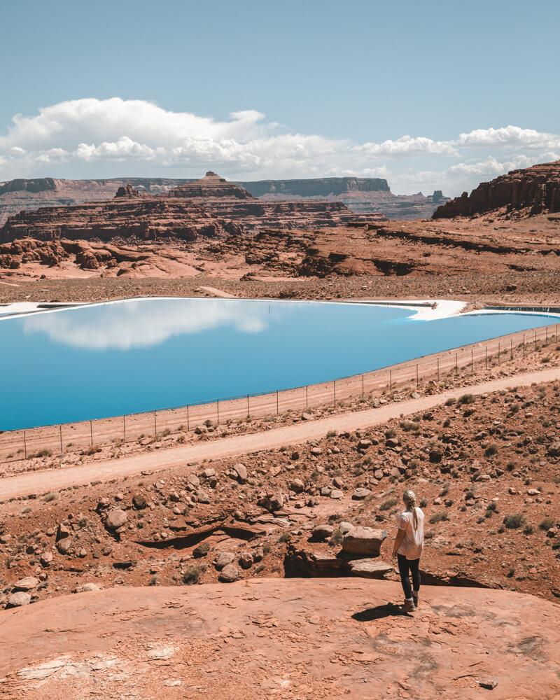 woman at the potash ponds in moab utah